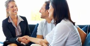 Couple greeting female consultant
